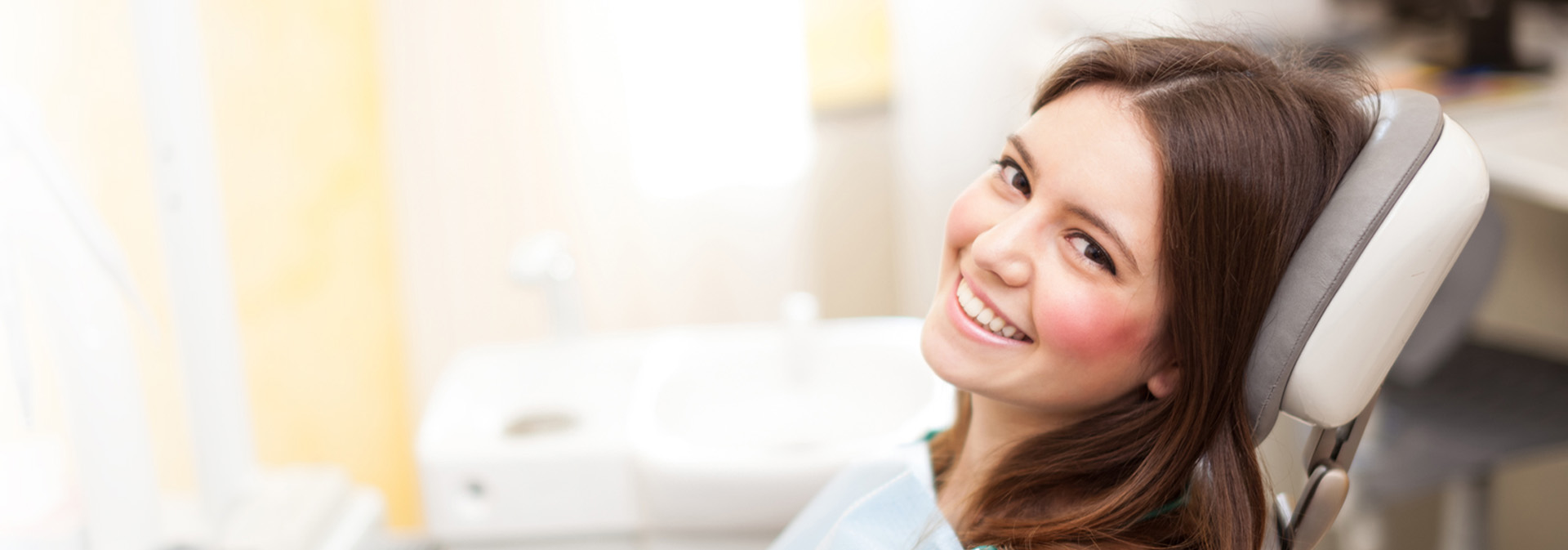 Woman after dental cleaning smiling