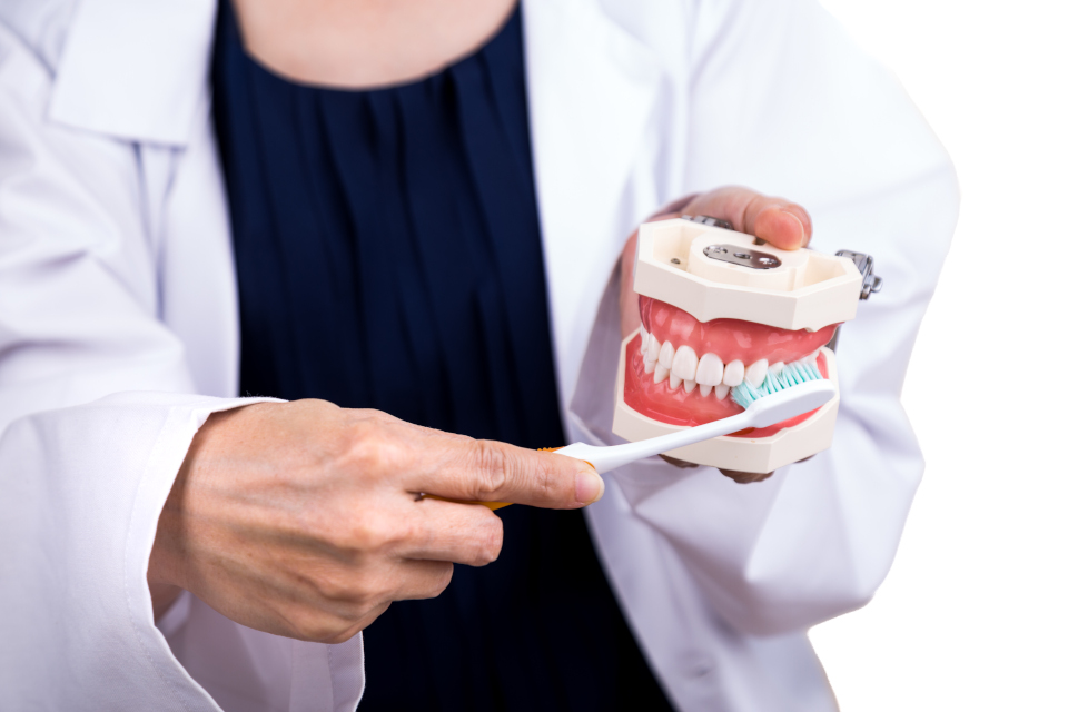 Series of dentist showing correct method of brushing teeth